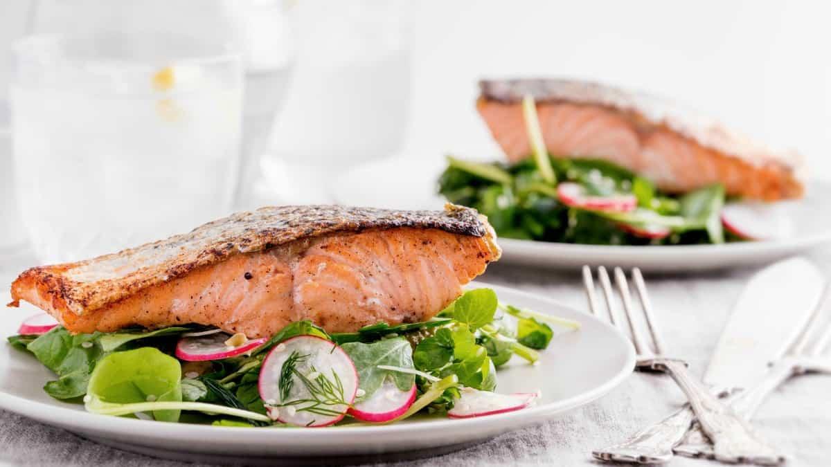 salmon arugula salad on plates