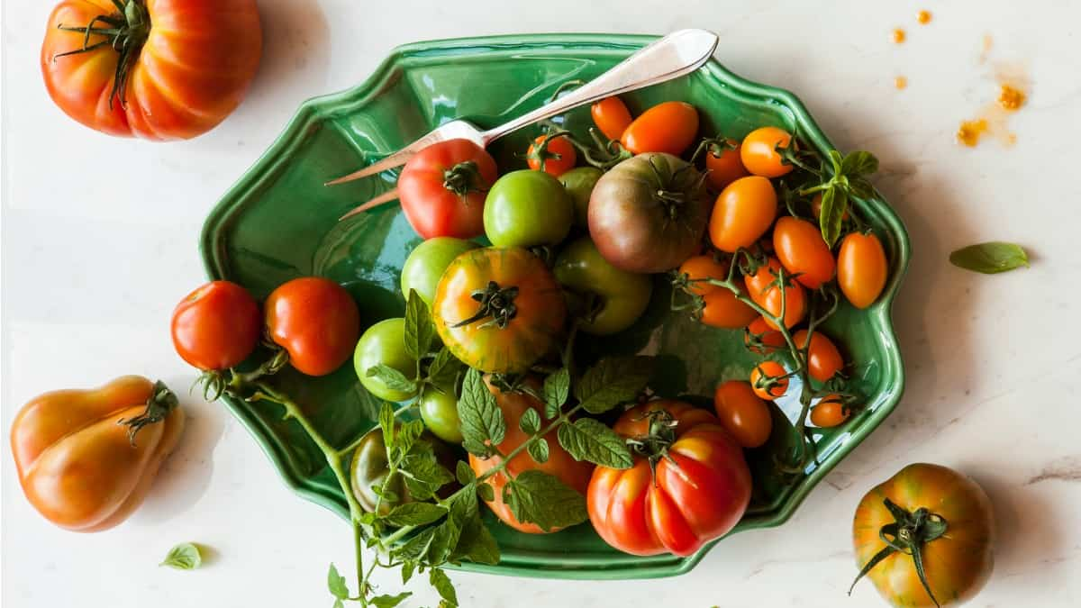 a bowl of colorful fresh heirloom anti inflammatory tomatoes