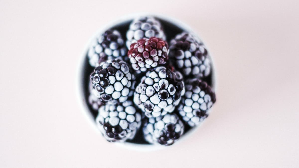 healthy frozen blackberries in a bowl