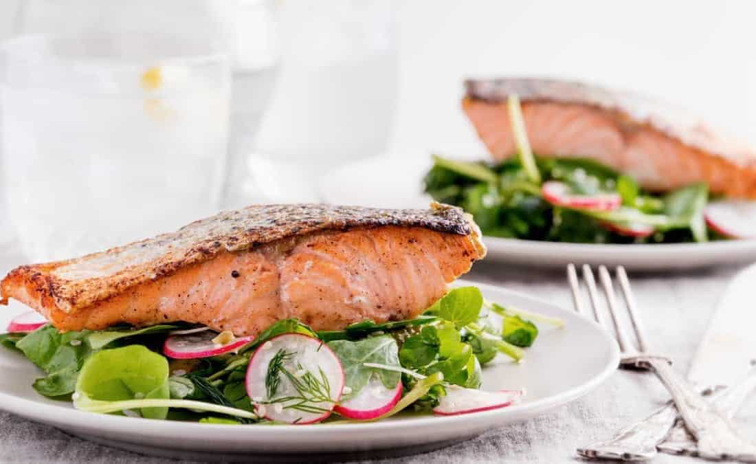 Pan-Seared Salmon on Arugula Salad with Tahini-Citrus Dressing