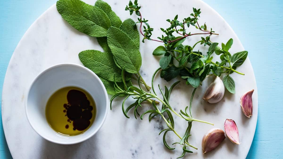 herbs, spices, oil on platter for salt alternative