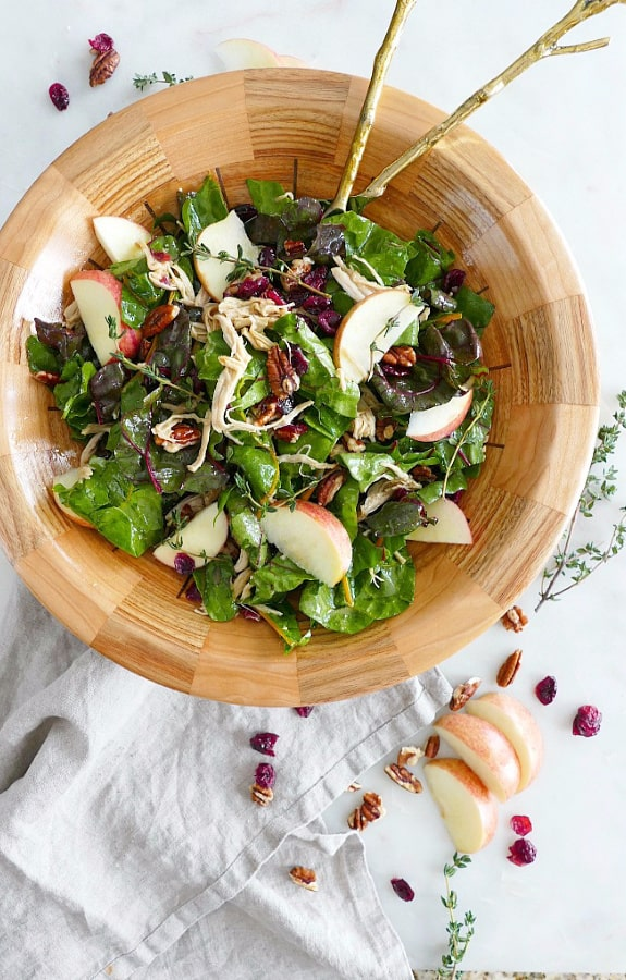 Maple Swiss Chard Salad with Turkey in wooden bowl with cranberries