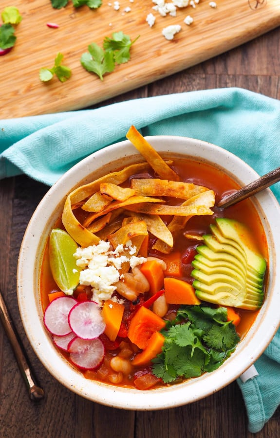 Butternut Squash Tortilla Soup with White Beans, seasonal produce, and avocado for warm fall meal