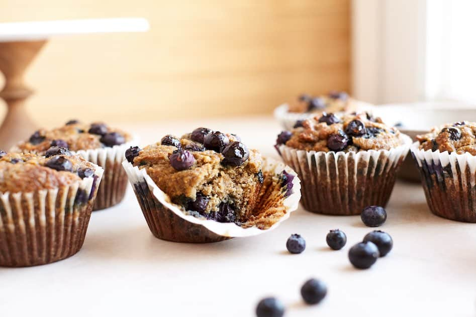 gluten free blueberry muffins on counter with blueberries