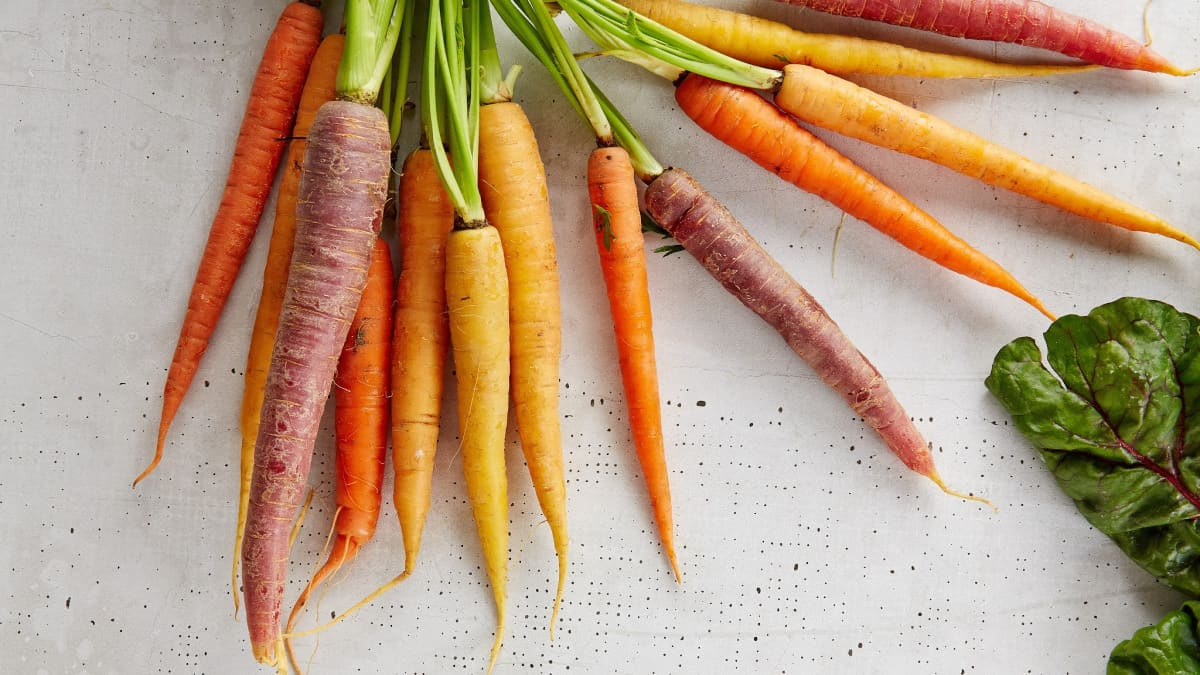 array of colorful carrots, a vitamin a loaded food