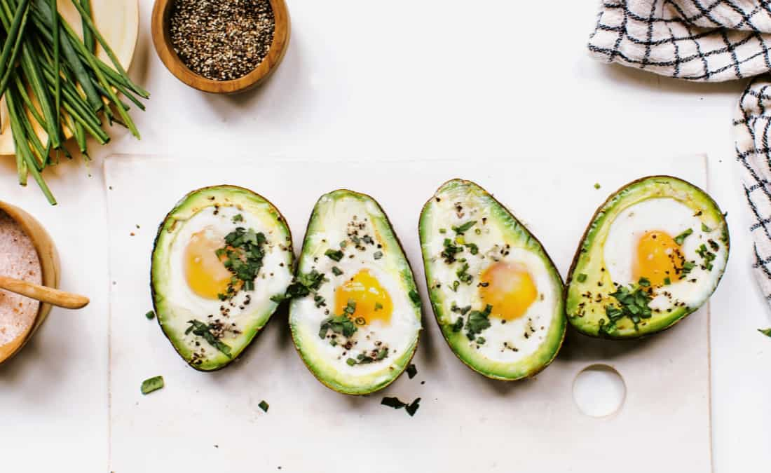 Baked Avocado Eggs with Fresh Herbs