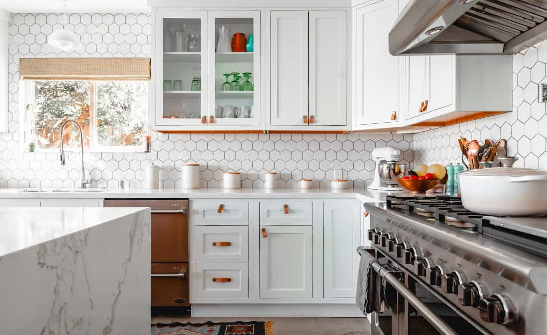clean and organized kitchen with marble counter top