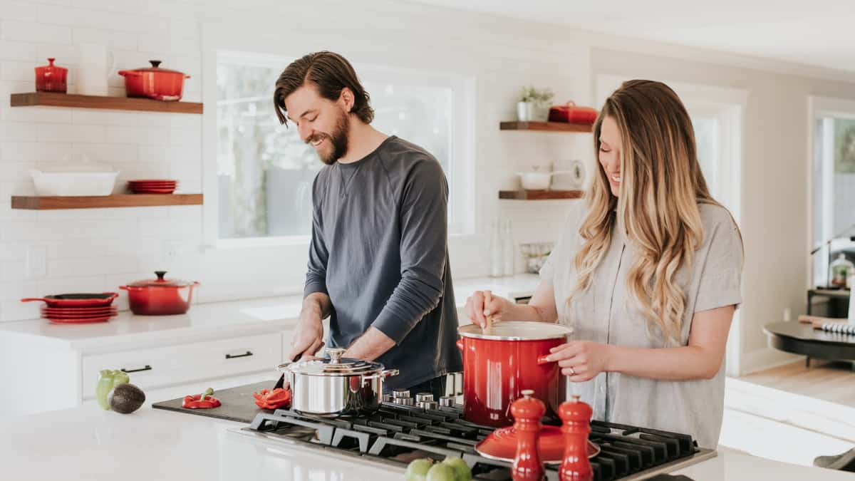 couple cooking in the kitchen with good food handling safety