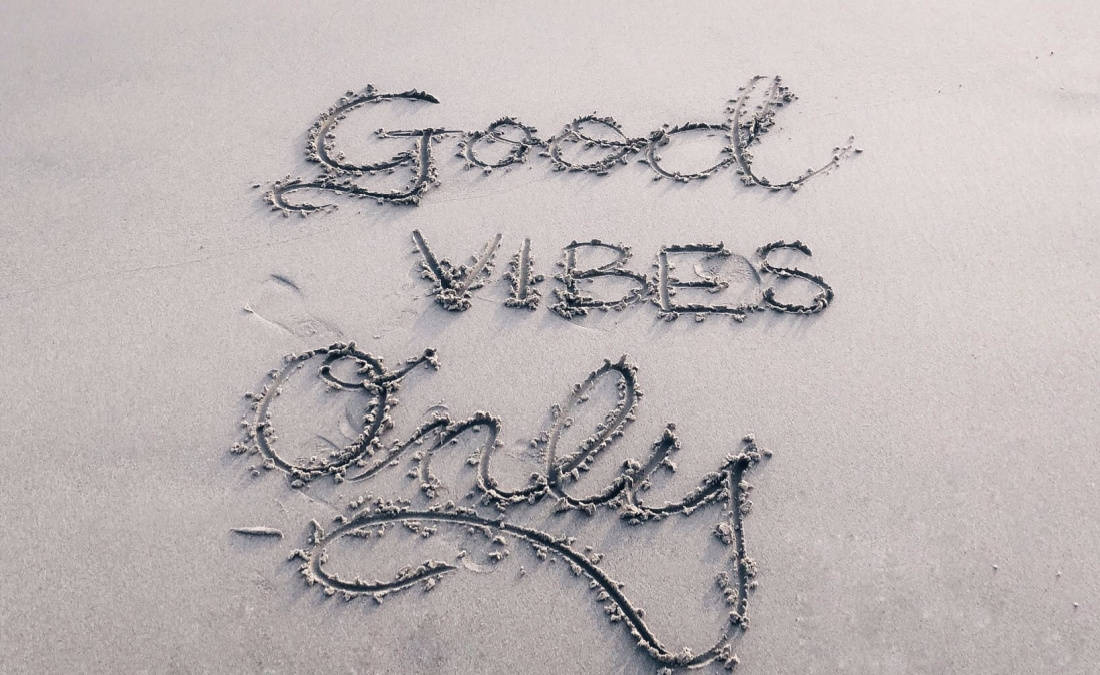 good vibes only written on sand for attitude of gratitude
