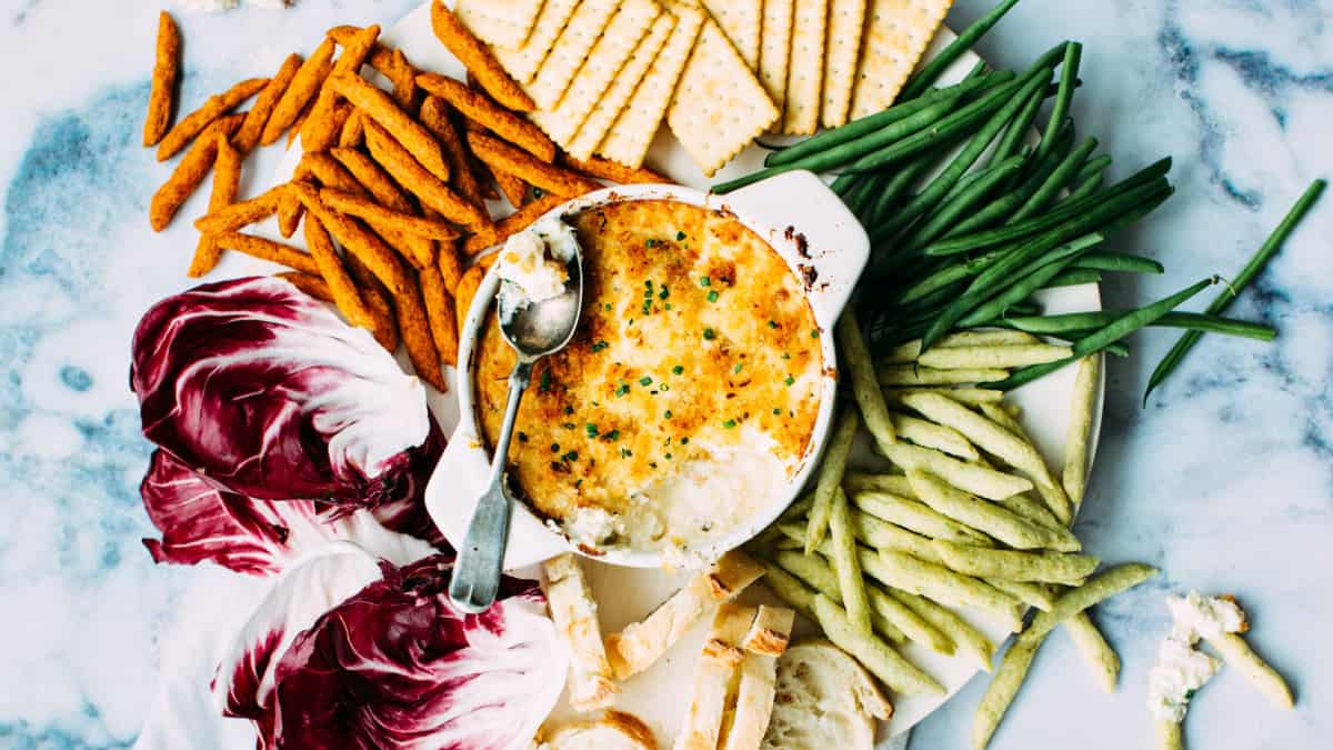 plant based appetizer with veggie crudites, crackers, and dip