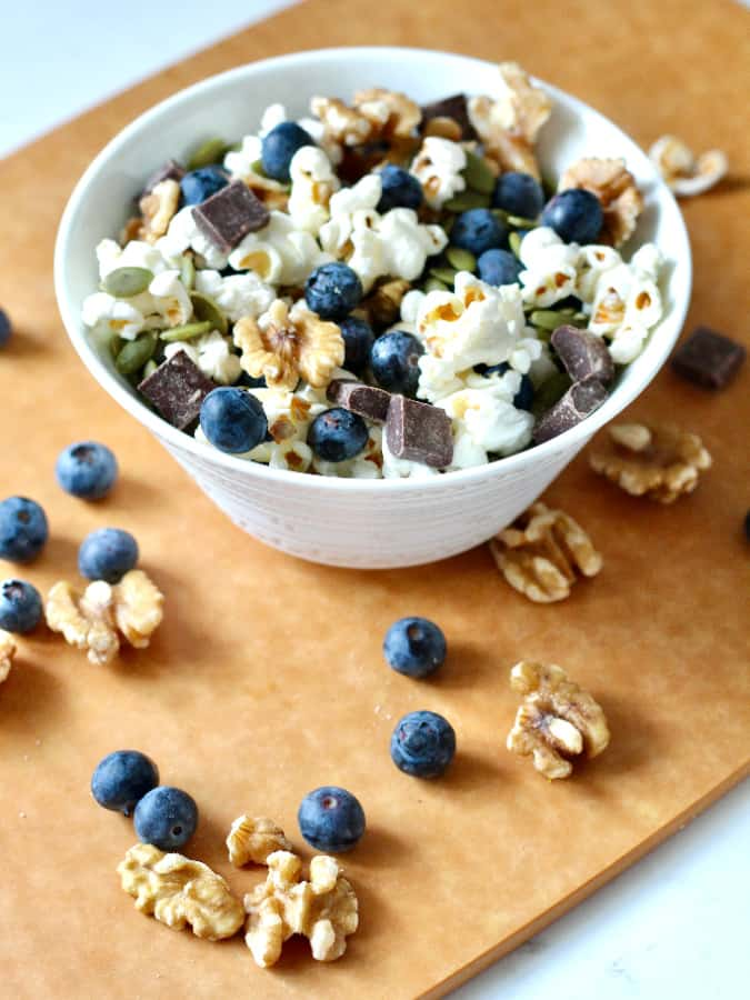 blueberry popcorn trail mix in a white bowl