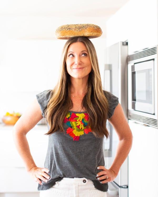 Patricia Bannan balancing bread in kitchen