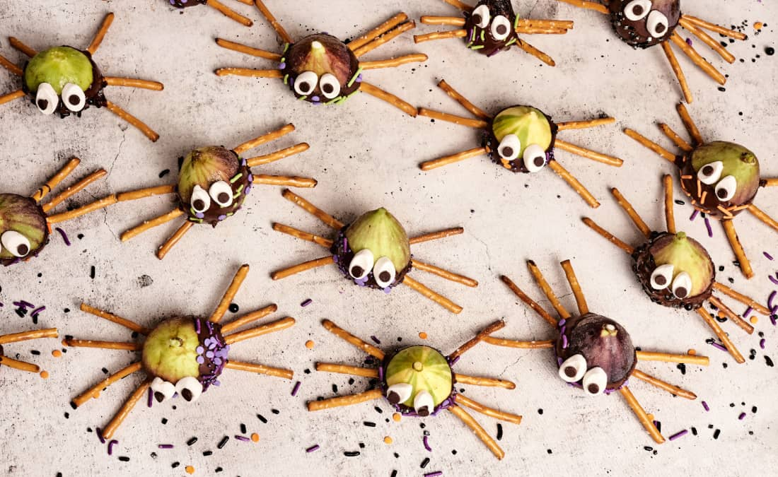 spider snacks with pretzels, chocolate, sprinkles, and marshmallows