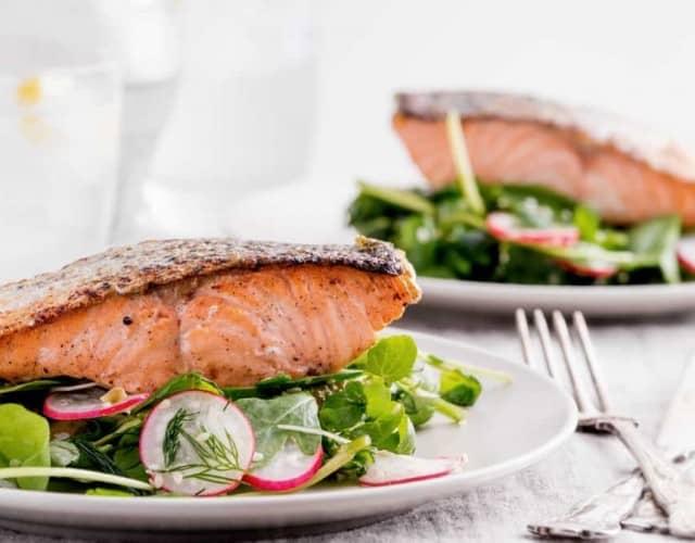 Pan-Seared Salmon on Arugula Salad with Tahini-Citrus Dressing